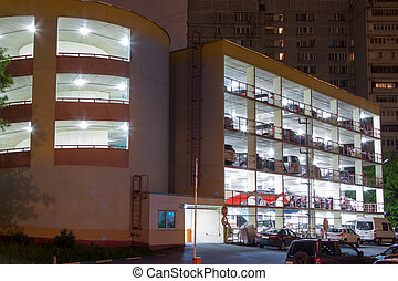 multistory brightly lit parking lot at night