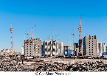 Multistory building and tall cranes