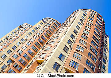 Multistory building - Multi-storey building on the blue sky...