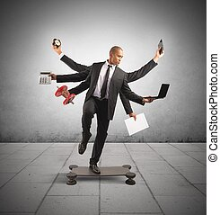 Multitasking concept with businessman at work doing gymnastics
