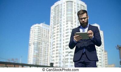 Multitasking Businessman - Smart businessman approaching...