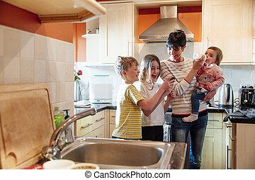 Multitasking Mum with her Children at home