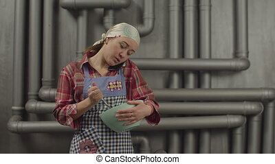 Multitasking woman talking on phone while cooking - Pretty...