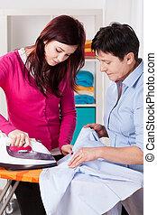 Mum and daughter during ironing