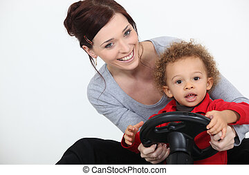 Mum and son playing with a toy car