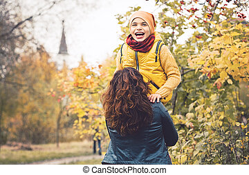 Mum and son together. Little child boy having fun