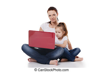 Mum with a daughter at the laptop