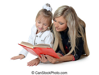 Mum with a daughter read book