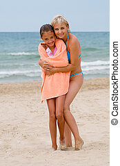 Mum with daughter on a beach