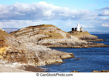 Mumbles lighthouse Bracelet Bay on the Gower Peninsular West Glamorgan Wales UK a popular Welsh coastline travel destination landmark attraction for tourist visitors to the city of Swansea stock photo