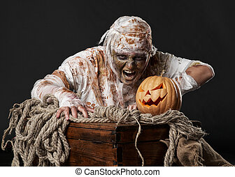 mummy in the studio with pumpkin and rope