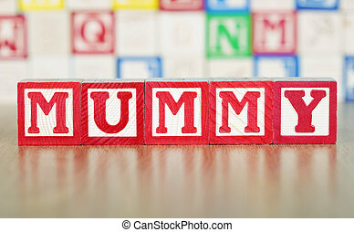 Mummy Spelled Out in Alphabet Building Blocks