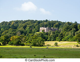 Muncaster Castle nestles in woodland on the edge of Lake District in England