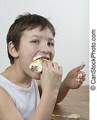 Munching on a cream bun