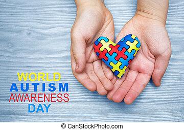 mundo, autism, conocimiento, día, rompecabezas, o, rompecabezas, patrón, en, corazón, con, autistic, niño, manos