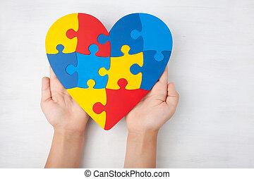 mundo, autism, conocimiento, día, salud mental, cuidado, concepto, con, rompecabezas, o, rompecabezas, patrón, en, corazón, con, niño, manos