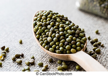 Mung Beans in wooden spoon.