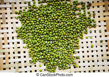 Mung beans or green beans on bamboo threshing basket with mung beans seed