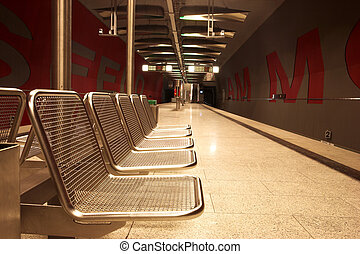 Munich #34 - Chairs in a train station.