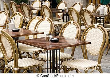 munich street cafe - typical munich stgreet cafe with wicker...