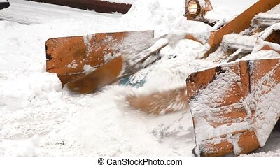 Municipal snow removal machine grabs snow from the street - ...