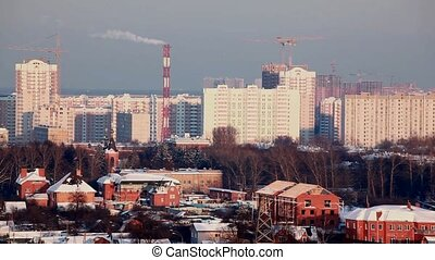 municipal thermal power station in big city smokes in sky