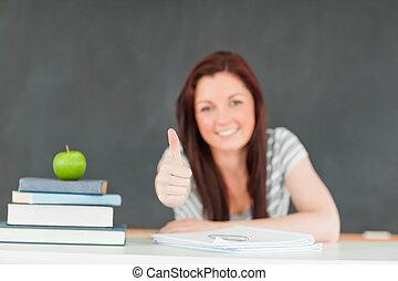 muntre, cute, student, hos, den, tommelfinger oppe