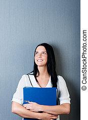 mur bleu, femme affaires, contre, relieur, tenue