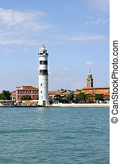 Murano island with lighthouse, view from sea