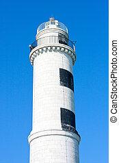 Murano Lighthouse before blue sky, Venice, Italy