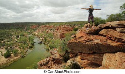 Murchison River woman enjoying - Happy blonde woman with...