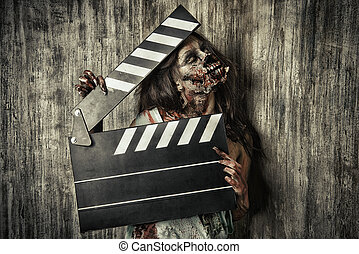 murder film - Filming a horror movie. Female zombie holding...