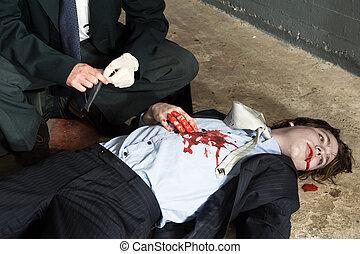Murder investigation - Police inspector hovering over a...