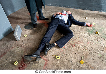 Businessman lying on the concrete floor of a basement, being shot, surrounded by evidence placards, and a man wearing a long overcoat hovering over the body