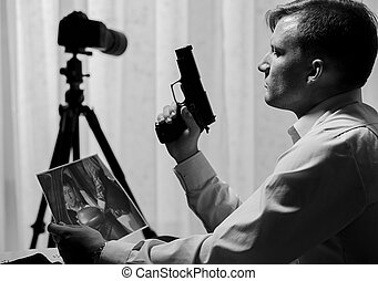 Murderer watching picture of victim