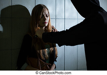 Murderer with knife and scared woman
