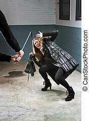 Murdering - Woman being attacked by a criminal with a ...