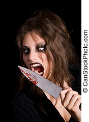 Murderous creature - Very scary woman about to lick the...