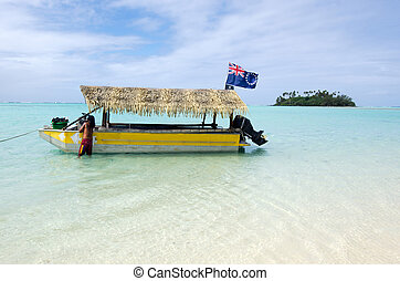 RAROTONGA - SEP 17:Tourist boat over Muri Lagoon in Rarotonga on Sep 17 2013.Cooks Islands are largely unspoiled by tourism with 100,000 visitors a year. They one of the world's most remote Islands.