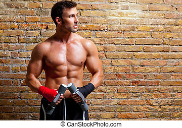 muscle boxer man with fist bandage and weights - muscle...