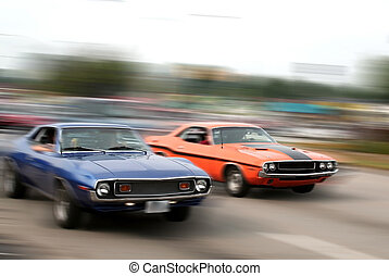 Muscle Cars - red and blue muscle car cruise in mi