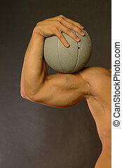 Muscle - male arm with generic sports ball