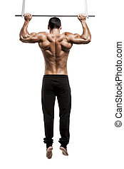Muscle man in studio making elevations, isolated over a...