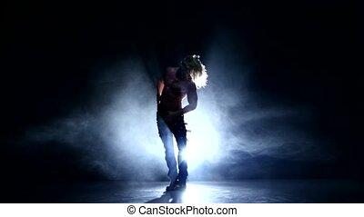 Muscle man model dancing in studio, smoke