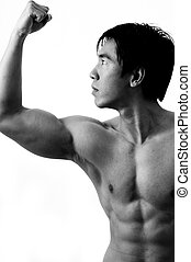 Muscle Pose - A muscular male model posing in black and...
