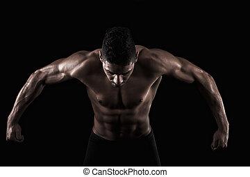 muscled, hombre, en, un, fondo negro