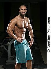 muscles, fléchir, jeune homme