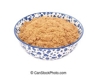 Muscovado sugar in a china bowl