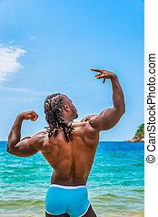 Muscular African American Man Posing on the Beach