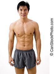 Muscular Asian - A muscular asian man in running shorts